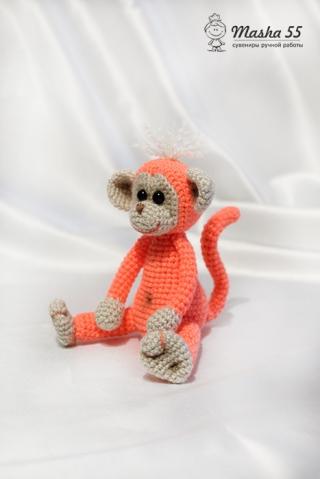 Розовая обезьянка